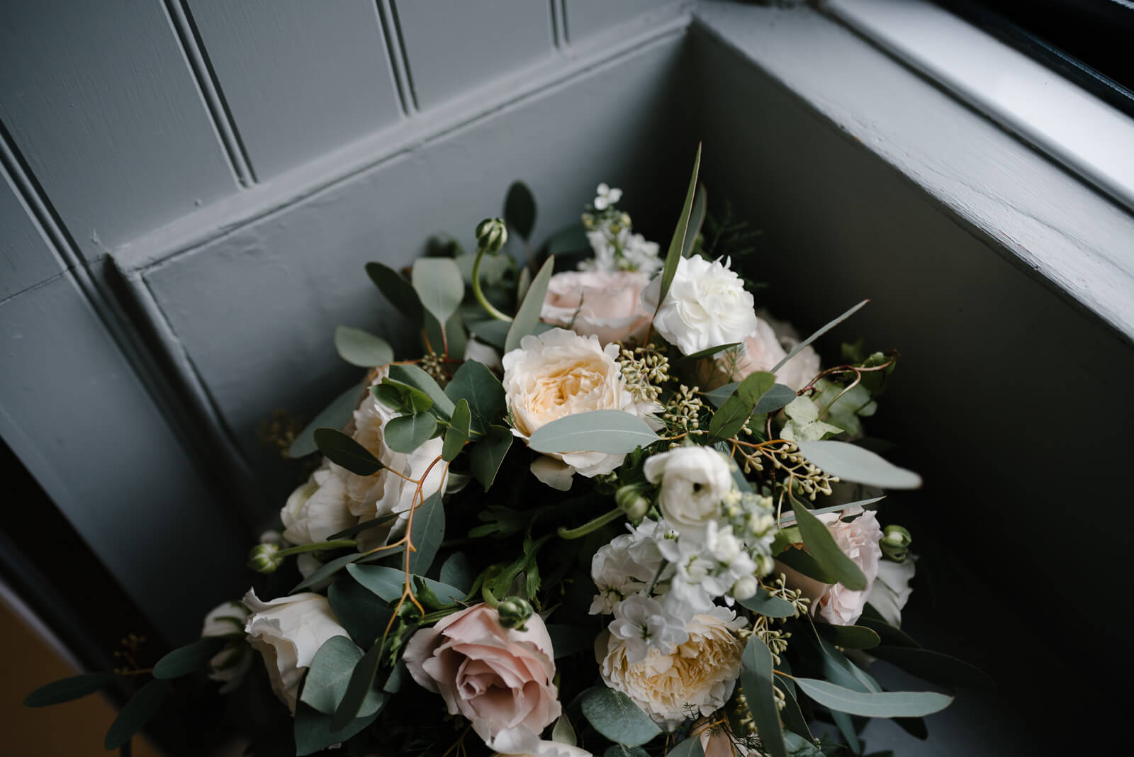 Cinematic photographs of Wilshire brides cream, pink and green floral bouquet