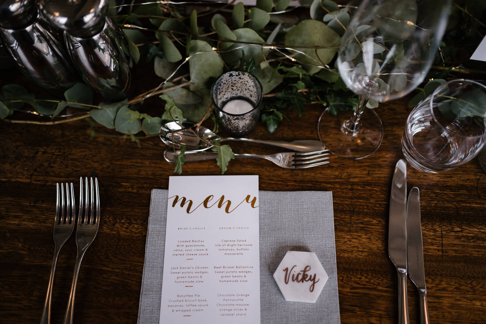 marble and copper stationery paired with eucalyptus and succulent table decor
