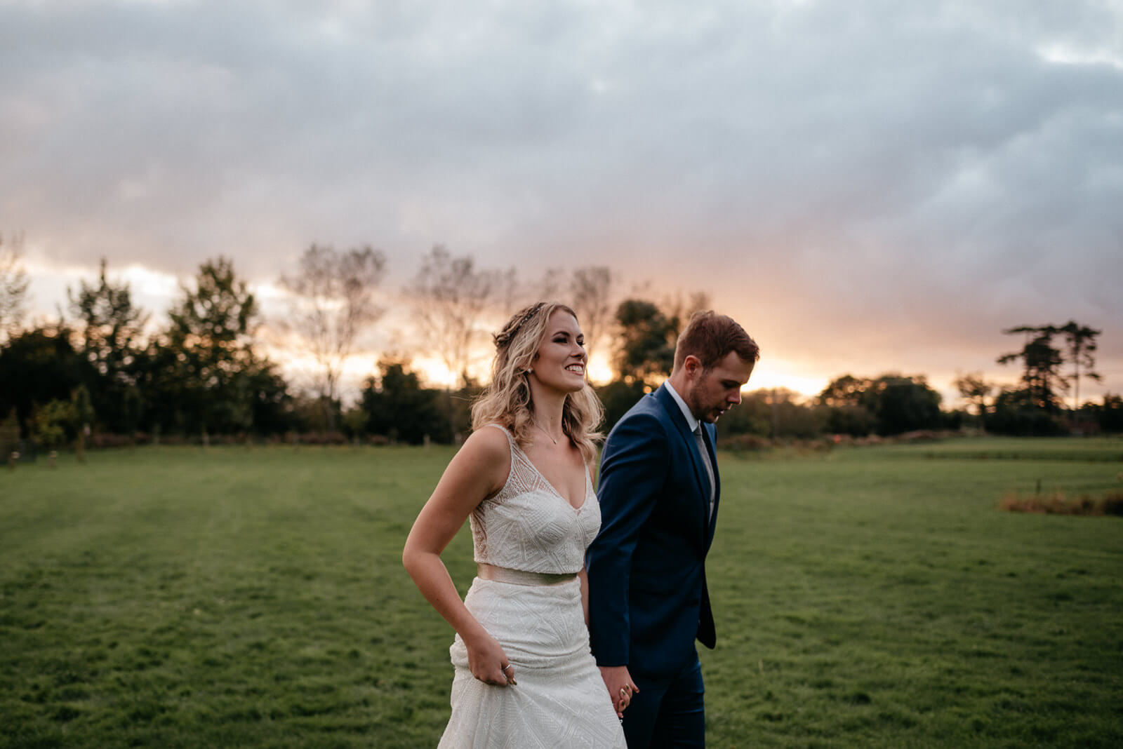 bride and groom leave reception for sunset portraits at autumn Wiltshire Wedding