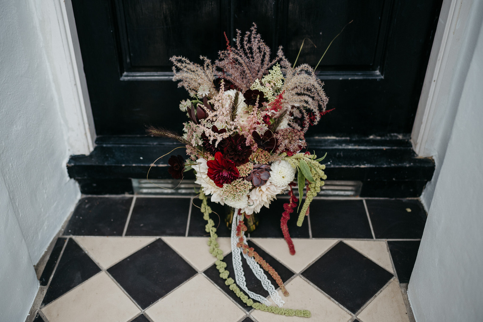 dark, sumptuous bouquet of dark wine and white dahlias, succulents, chocolate cosmos and astilbe by London florist Elie Lyons Flowers