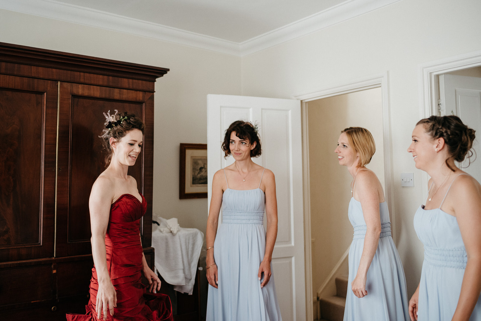 Bride smiles with her bridesmaids while getting ready for her London Wedding at Battersea Arts Centre