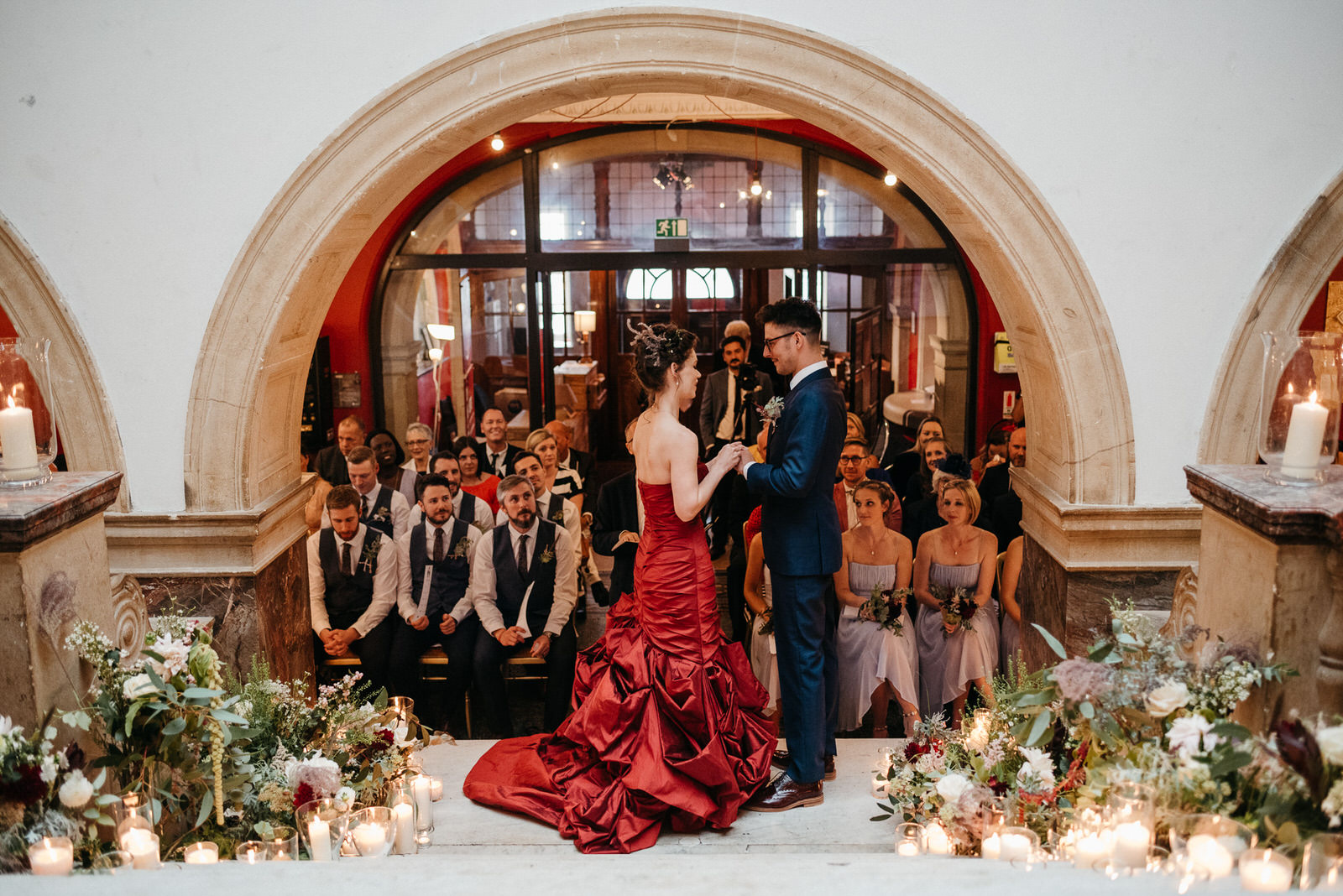 bride and groom kiss at the bottom of the stairs in Battersea Arts Centre