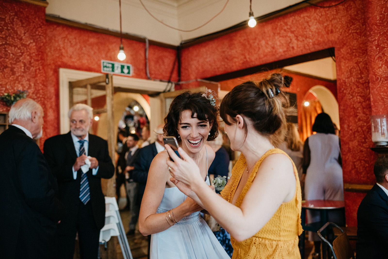 bridesmaid laughs with friends at creative London Wedding