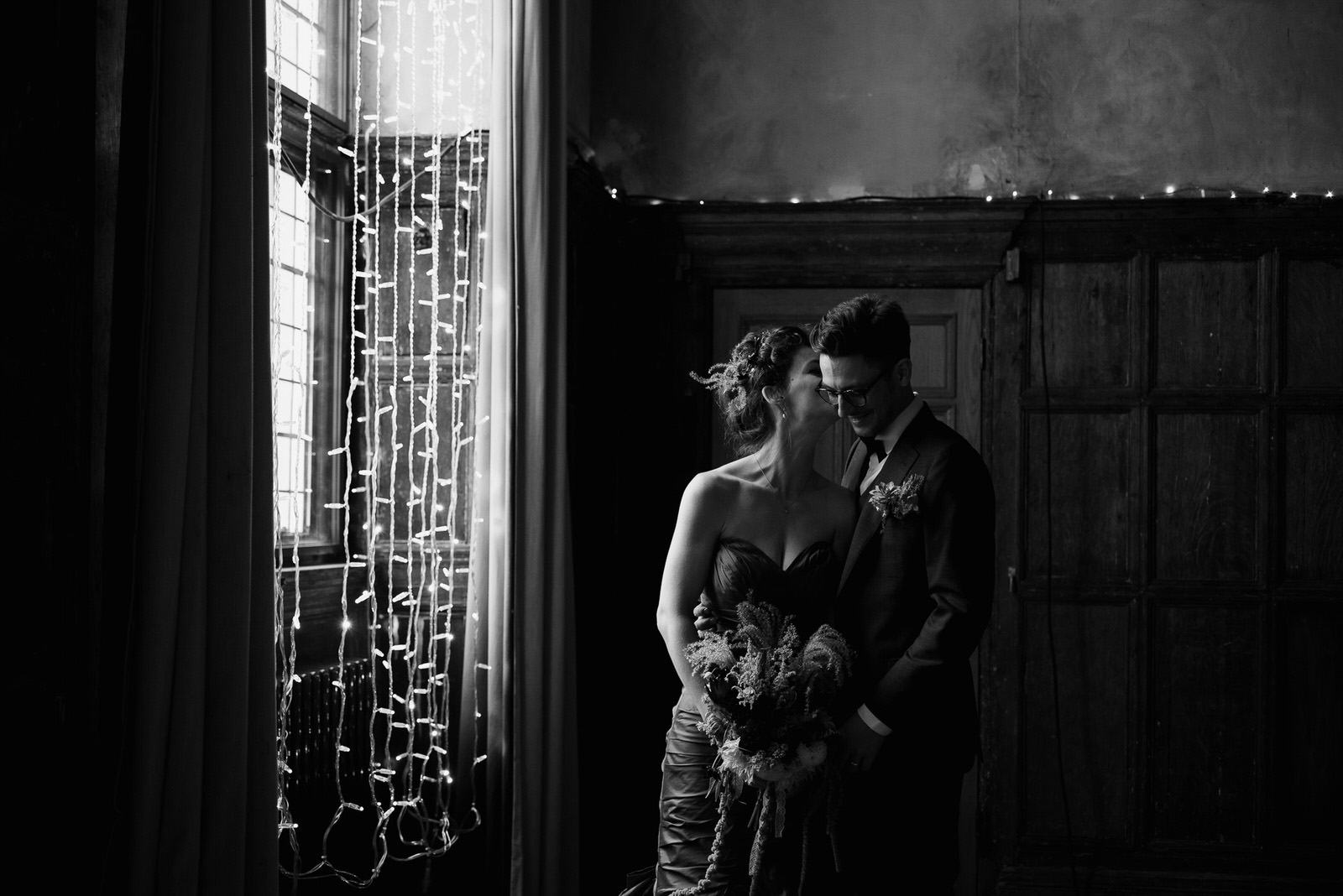 black and white portrait of bride and groom inside London wedding venue, Battersea Arts Centre