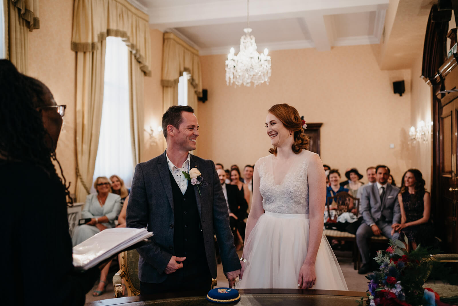 bride and groom laugh during their ceremony at Chelsea Old Town Hall