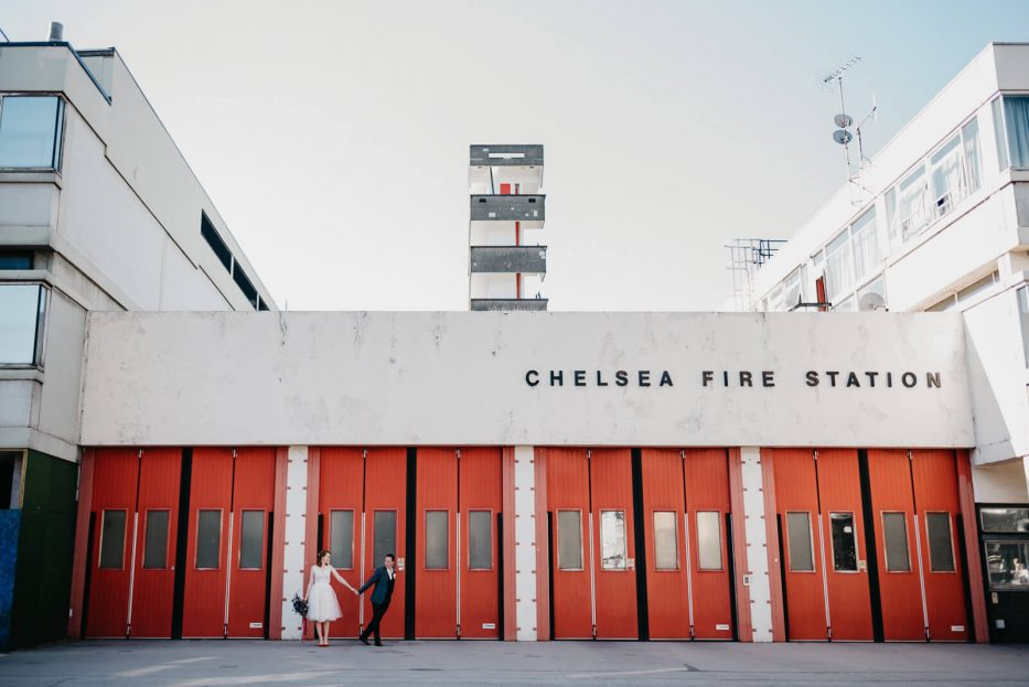 Couple in front of Chelsea Fire Station after marrying at Chelsea Old Town Hall