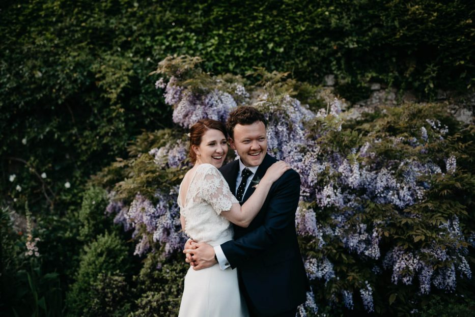 happy couple during candid portraits at Slebech Park wedding in Pembrokeshire
