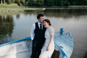 Couple take boat trip during their wedding reception at Slebech Park Estate in Haverfordwest
