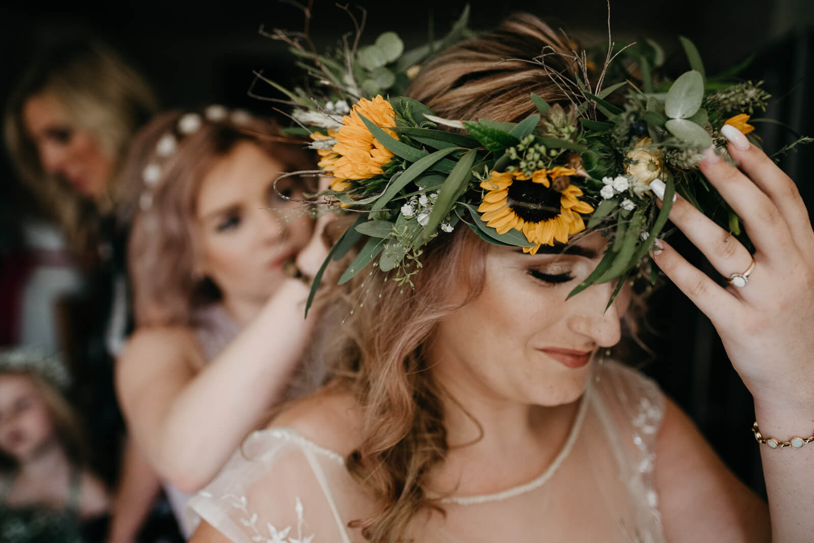 Bride wears a sunflower crown for her Earthy Bohemian Wedding