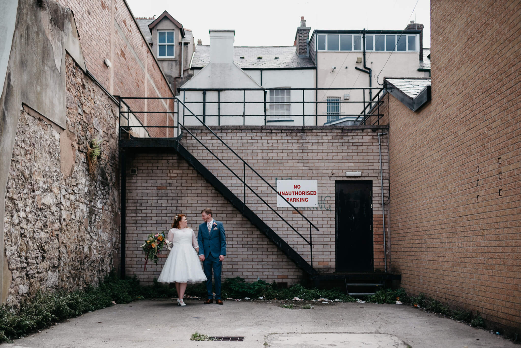 urban portrait of creative, modern couple during their wedding photos