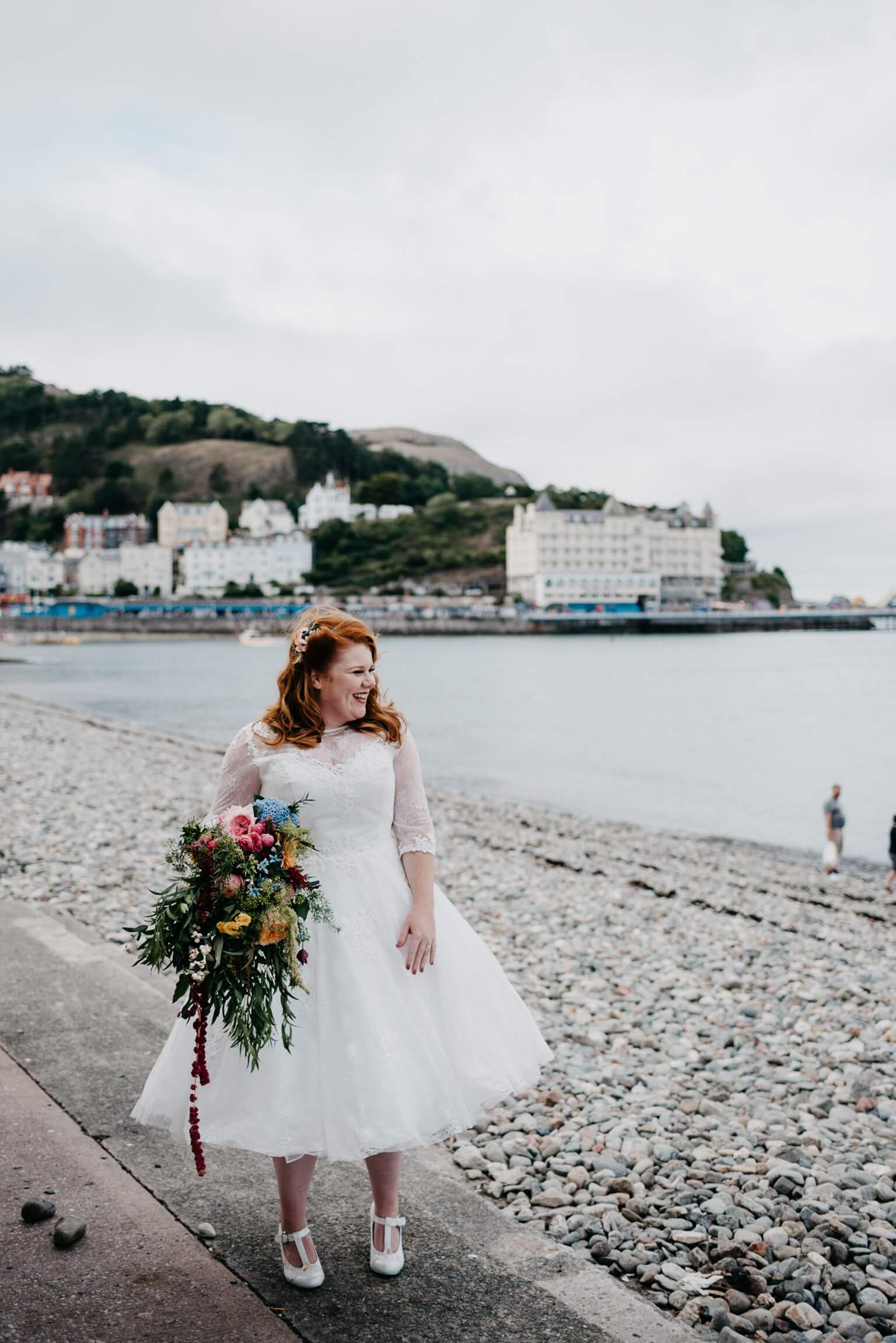 beautiful redhead bride at llandudno seafront