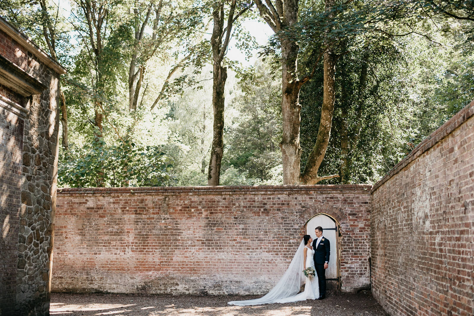 Stylish Bride and Groom during their wedding portraits at Wotton House