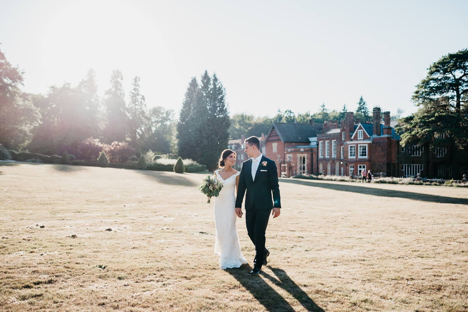 sunset portrait of bride and groom at Dorking wedding venue, Wotton House