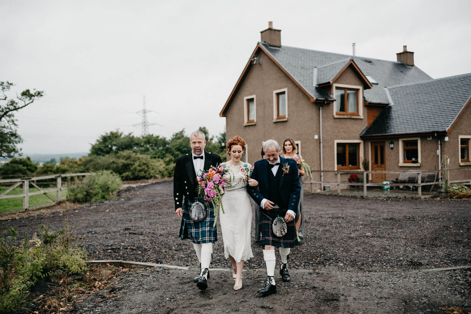 Bride walks with her dads to marry at her Farm Wedding in Dunblane, Stirling