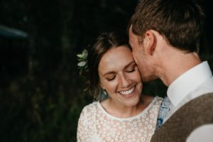Glowing Bride and Groom sharing a moment at their Fforest Wedding in Cardigan