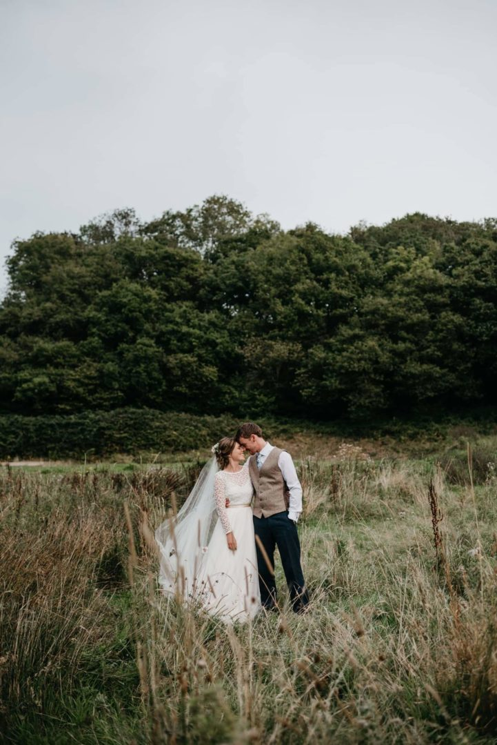 Couple kiss during their wedding celebration in photograph by South Wales Wedding Photographer Elaine Williams