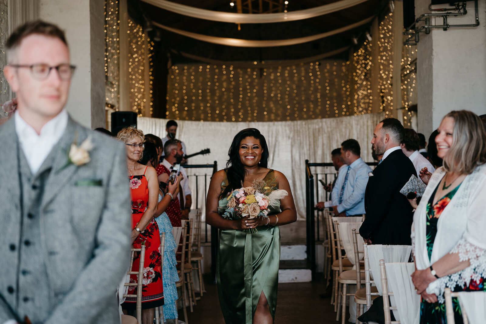 Bridemaid walks down aisle at Rosedew Farm Wedding