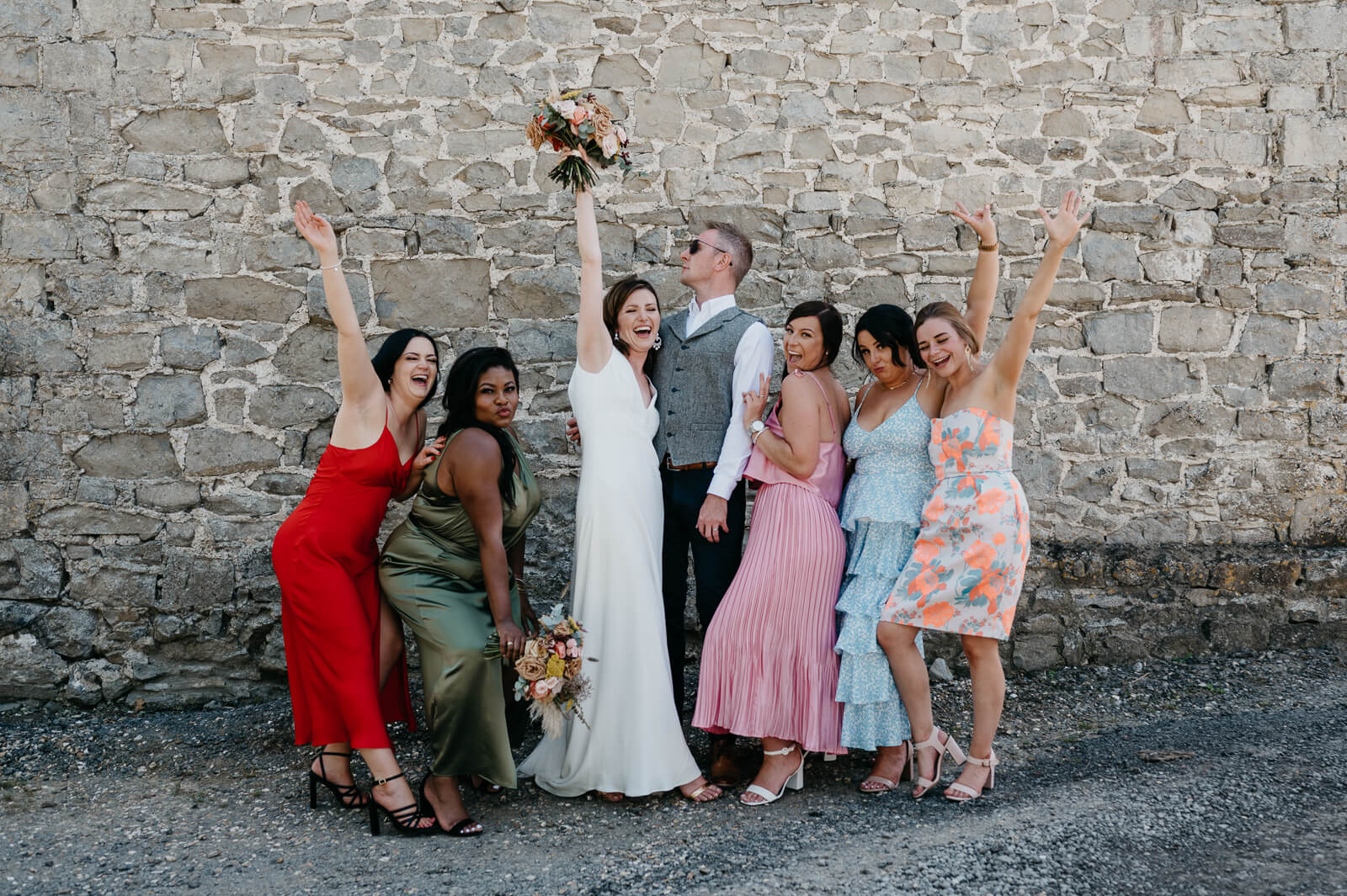 bride and groom pose with friends at their llantwit major wedding